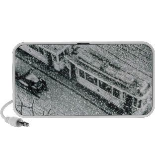 Urban traffic during snowfall, historic photo notebook speaker
