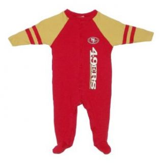NFL San Francisco 49ers Baby / Infant Comfortable Fit One Piece Footed Long Sleeve Bodysuit / Romper / Onesie   Red Yellow (Size 6 9 ) Clothing