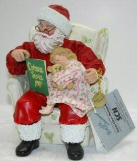 Possible Dreams� ClothtiqueTM American Artist Tom Browning Christmas Stories #15054 RETIRED Featuring Santa Sitting in a Chair reading a book title Christmas Stories to a Little Girl Who Has Fallen Asleep with a Teddy Bear In Her Arms   Holiday Figurines