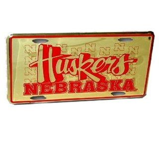University of Nebraska Lincoln UNL Cornhuskers  Gold Color Metal License Plate   3d HUSKERS logo design Sports & Outdoors